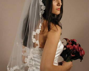 """Mantilla wedding veil with lace edging. Mantilla vil elbow length 30"""" long and 72"""" wide."""