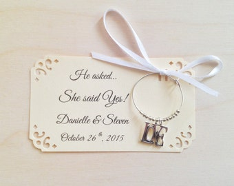 105 to 150 LOVE themed wine charm favors for She Said Yes! Perfect rehearsal dinner favors & engagement party favors. Fully personalized.