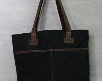 Bag made from waxed canvas and leather
