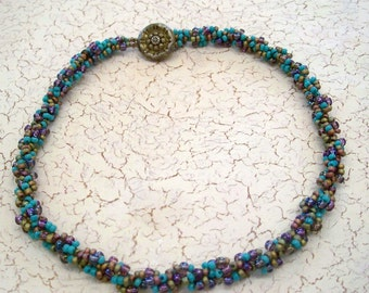 Turquoise and Iridescent Olive Seed Beads with Purple Drops Spiral Bead Woven Necklace by Carol Wilson of Je t'adorn