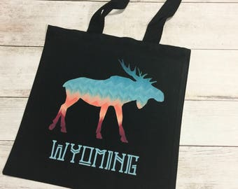 Wyoming Moose black tote bag - colorful chevron moose on a black canvas carryall bag