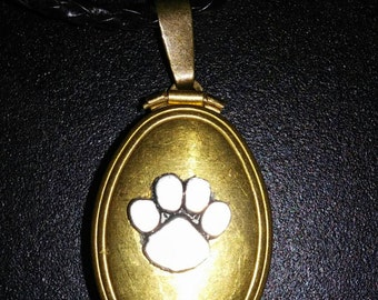 Bright brass multiphoto locket with paw on black cord