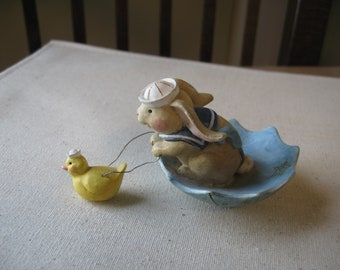 sailing bunny in umbrella with duck