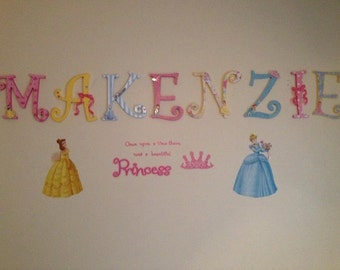 Disney Princess spells out your childs name. Hangs on wall.