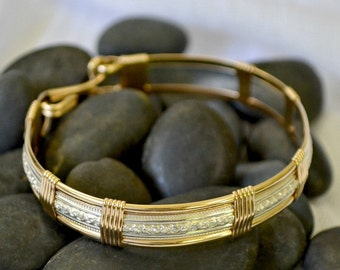 "Sterling silver and 14K gold filled wire wrapped bracelet. ""Cosmopolitan"""