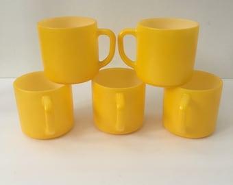 FireKing Mugs Bright Yellow Fired On Platonite Milk Glass Set of Five Mid Century Coffee Cups