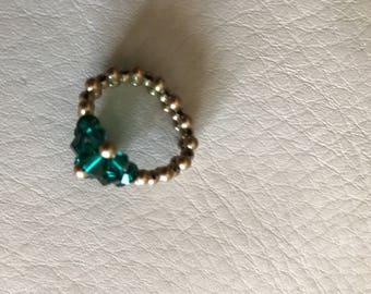Emerald green Swarovski crystals with gold-colored mini pearls.
