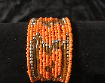 Orange cuff bracelet with gold details. Orange bracelet. Bohemian orange bracelet