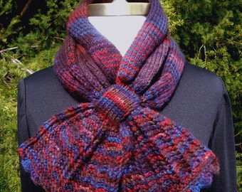 Multicolored Scood in knitted in red, brown, blue, and purple hues