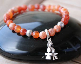 Bracelet with charm and fire agate beads
