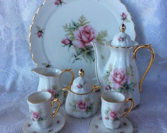 Beautiful Avon miniature porcelain toy size service tea set with teapot cups saucers sugar creamer and tray