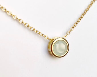 Blue opal glass dainty gold necklace.