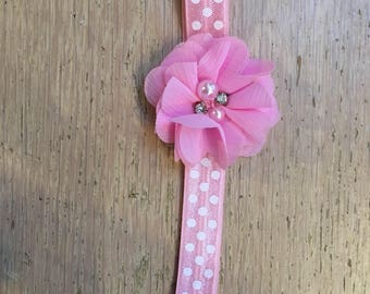 Baby headband pink with white dots with flower in pink