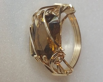 Whisky Quartz is a natural stone, here cushion cut and set east-west in a 14K gold filled prong setting with accent wires.   Size 7 1/2