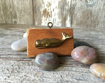 Miniature Brass Whale mounted on wood