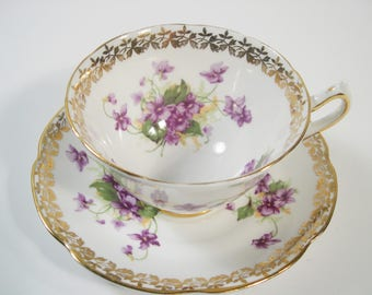 Collingwoods Tea Cup and Saucer, White and Gold teacup with Violets.