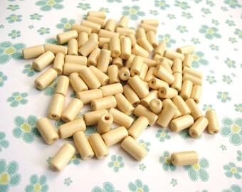 Perles tube en bois ivoire 12x6mm - 75 unités
