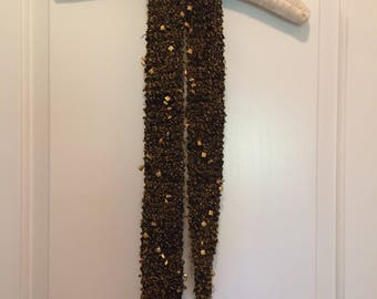 Handknit black and gold scarf with embellishments