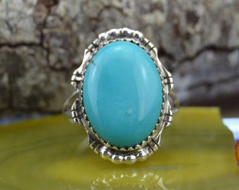 Navajo handmade sterling silver and an oval Kingman turquoise ring size 7.75