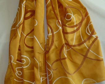 Mixed silk arabesques on orange background scarf