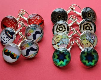 7 pairs of earrings with various glass cabochons