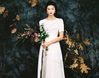 Cap sleeve sheath wedding dress with modest high neck bodice