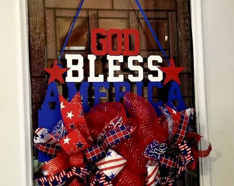 Patriotic door hanger with fabric bows