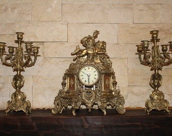 "Clock mantel ""Impérial"" and pair of candelabra."