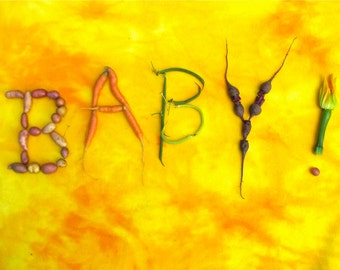 BABY! greeting card The tiniest baby veggies spell out the message on a cheerful background
