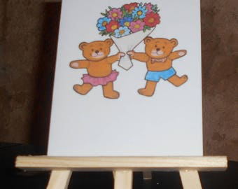 Card 2 bears with a bouquet of flowers
