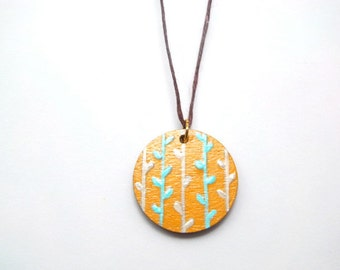reversible handpainted pendant in antique gold with leafy vines