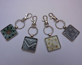 Square key chain with a beautiful fabric inserted under glass