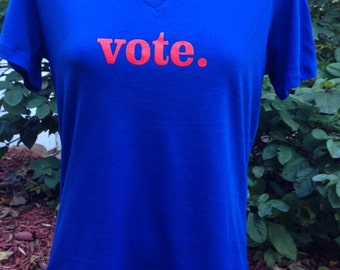 vote. women's v-neck 100% cotton Bella t-shirt. Wear your right to vote! Plus, FREE domestic shipping!!!