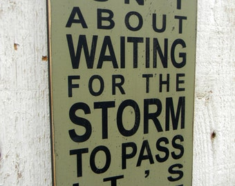 Life isn't about waiting for the storm to pass it's about learning to dance in the rain typography word art sign