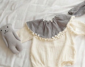 Long sleeved cotton linen blend romper with removable collar and poppers...
