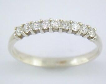 Peg Set Nine Diamond Half Eternity Ring