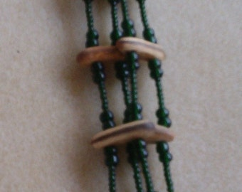 "4 Strand Necklace - Dark olivine green Ornela seed beads, Royal Poinciana seed spacer bars, 30"" long"