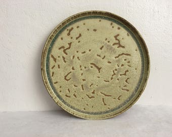 Sand colored plate with texture