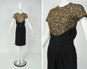 vintage 1940s black wiggle dress with scrolling gold sequins, waterfall drape skirt, keyhold back, peek-a-boo mesh bodice, size XS