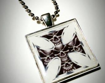 Cross with skull design