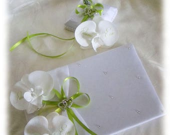 Guest book and penholder with artificial orchids and lime green ribbon to customize