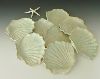Shell Plates fired in a coral blue glaze. These hand crafted dishes are the perfect size for cookies, spoon rests, or use as a soap dish!