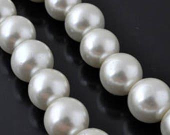 10 round ivory glass beads