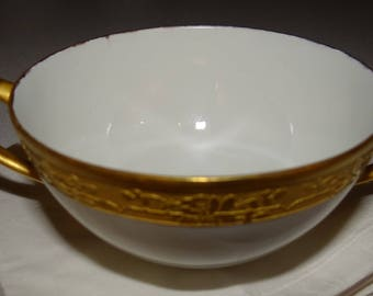 Hutchenreuther gold encrusted soup cup on white ground, and gold handles