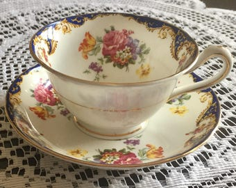 "Beautiful Antique ""Ye Olde English"" Grosvenor China Tea Cup and Saucer Blue with Floral Pattern"
