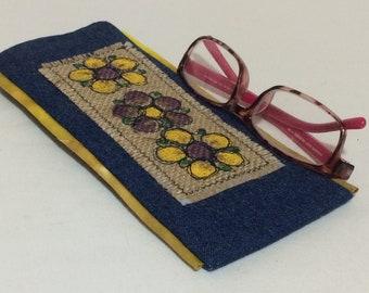 Glasses case in denim with hand painted flower design, outlined with free motion embroidery, padded and lined with contrast cotton fabric