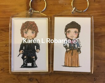 Jamie and Claire Fraser cartoon keychains or just Claire.
