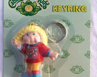 NOS Key Ring Cabbage Patch Kids Rollerblading Blonde CPK keychain Dorda Toys
