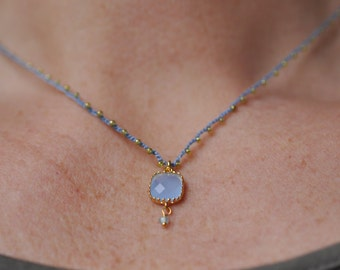 Dainty blue and gold crocheted beaded pendant necklace