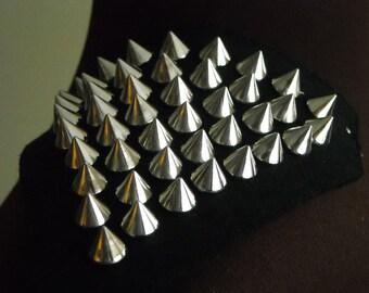 1 pair of shoulder studs / spike trims, silver spikes on black felt